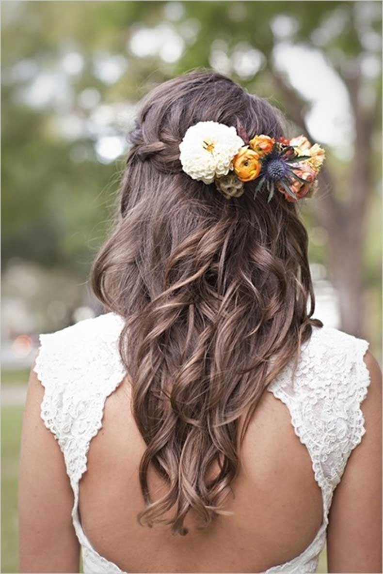 wedding-hair-braid-downhow-to-wear-flowers-in-your-hair--inspiration-for-the-boho-bride-wl7gxwth