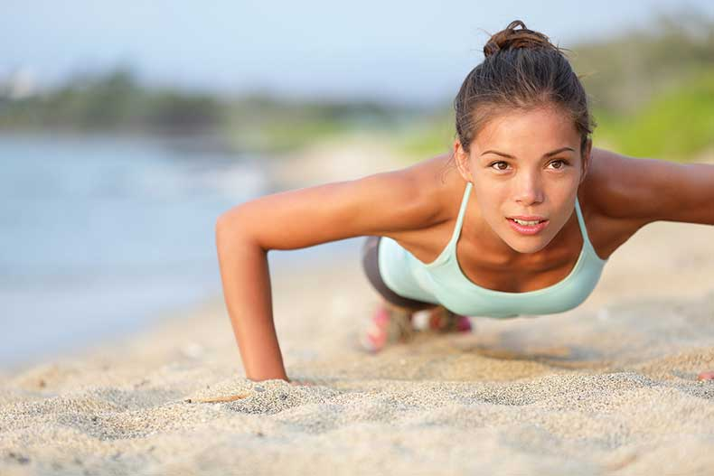 Bigstock_-30414412-Push-ups-fitness-woman-doing-pushups-outside-on-beach.-Fit-female-sport-model-girl-training-crossfit