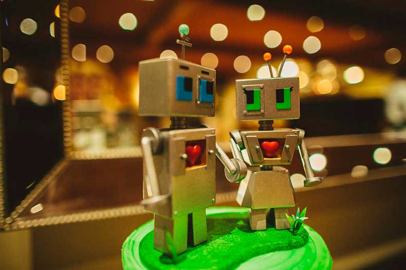 tiny-green-cake-topped-off-humorous-robot-wedding-toppers