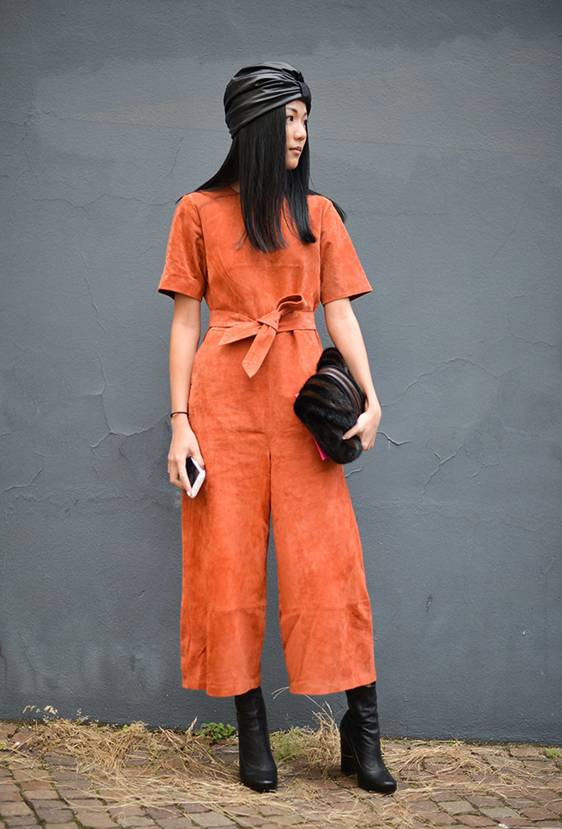 how-to-wear-orange-outfit-suede-jumpsuit