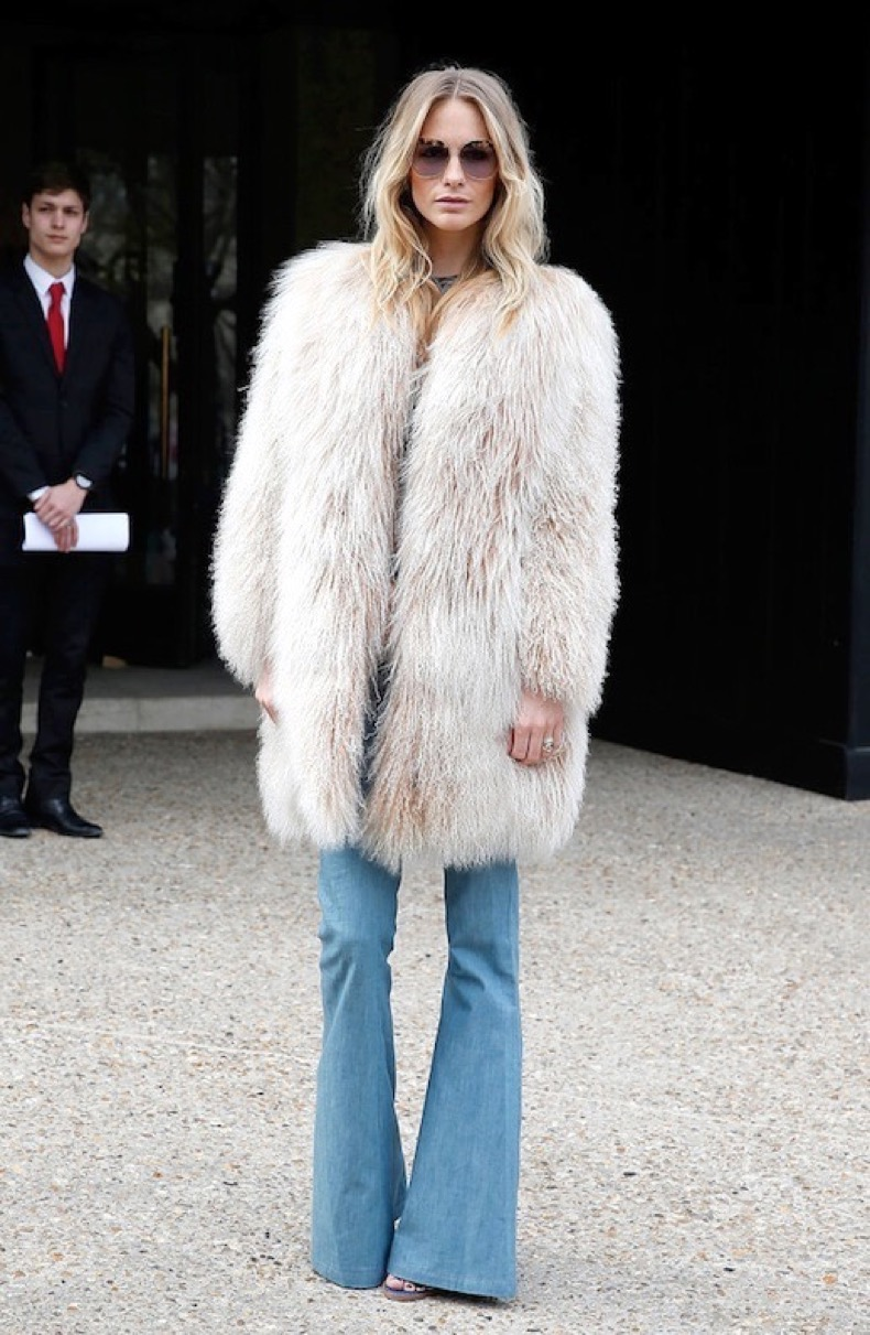Le-Fashion-Blog-Fall-Street-Style-Poppy-Delevingne-Round-Sunglasses-Shaggy-Mongolian-Fur-Coat-Denim-Flares-Via-Pop-Sugar