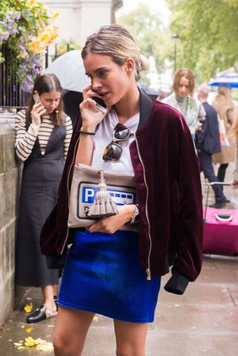 burgundy-velvet-baseball-jacket-mini-skirt-cheeky-kitchy-clutch-bag-purse-tassle-purse-whtie-tee-lfw-london-fashion-week-street-style-fall-otufits-via-popsugar-640x958